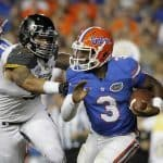 Oct 18, 2014; Gainesville, FL, USA; Florida Gators quarterback Treon Harris (3) runs with the ball as Missouri Tigers defensive lineman Shane Ray (56) defends during the first half at Ben Hill Griffin Stadium. Mandatory Credit: Kim Klement-USA TODAY Sports