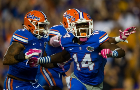 Florida Gators celebrating as a team on defense