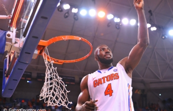 Patric Young working to NBA goals while watching Gators