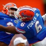 Florida Gators linebacker Antonio Morrison and Florida Gators defensive lineman Dante Fowler, Jr. celebrate after a Eastern Kentucky turnover. Florida Gators vs Eastern Kentucky Colonels. November 22th, 2014. Gator Country photo by David Bowie.