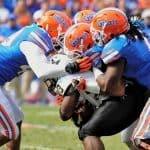 Gator_Football_Defense_Surrounding_Vanderbilt_Bowie