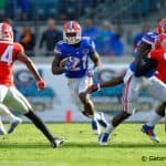 Florida Gators running back Kelvin Taylor rushes downfield in the second quarter.  Florida Gators vs Georgia Bulldogs. November 1st, 2014. Gator Country photo by David Bowie.