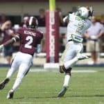 Sep 6, 2014; Starkville, MS, USA; UAB Blazers wide receiver Jamari Staples (2) reaches up and grabs the ball while guarded by Mississippi State Bulldogs defensive back Will Redmond (2) during the game at Davis Wade Stadium. Mandatory Credit: Spruce Derden-USA TODAY Sports