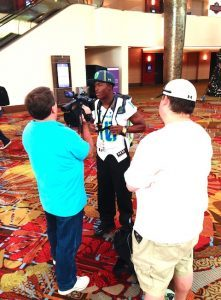 Running Back Ray-Ray McCloud talks with reporters at UA-AA Registration