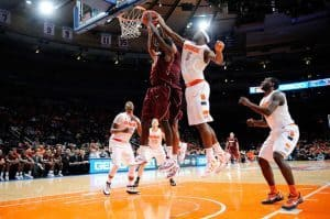 C.J. Fair #5 of the Syracuse Orange and Dorian Finney-Smith #15 of the Virginia Tech Hokies battle for a rebound during the 2011 Dick's Sporting Goods NIT Season Tip-Off (November 22, 2011 - Source: Patrick McDermott/Getty Images North America)