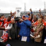 Jan 3, 2015; Birmingham, AL, USA; Florida Gators head coach interim D.J. Durkin is presented the trophy after winning the Birmingham Bowl against East Carolina Pirates at Legion Field. Mandatory Credit: Marvin Gentry-USA TODAY Sports