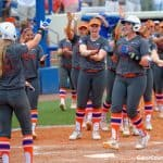 Gators softball celebrate a win/David Bowie