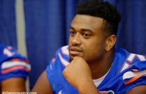 Caleb Brantley waits to sign autographs for fans at the Florida Gators 2015 fan day - Caleb Brantley - Florida Gators - University - of - Florida - Gainesville - Florida