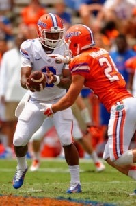 Running Back Case Harrison Takes Handoff From Quarterback Treon Harris During Orange and Blue Debut Florida Gators Football 681x1024