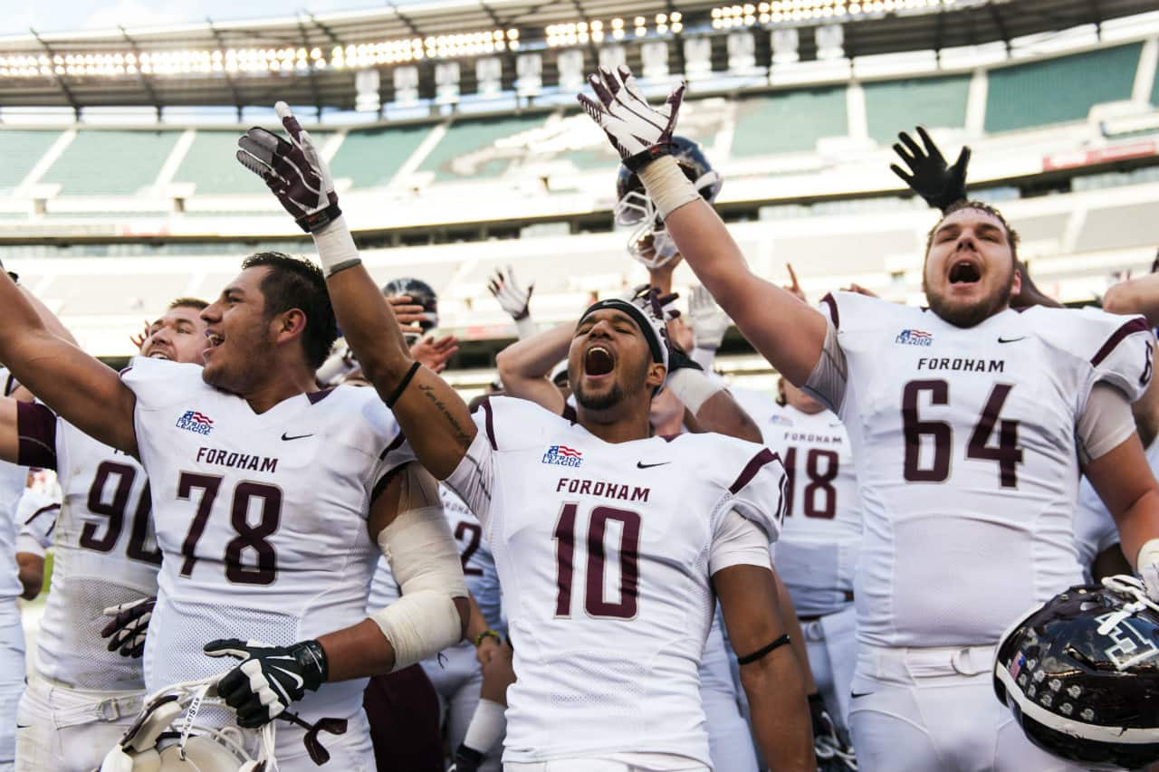 Sep 14, 2013; Philadelphia, PA, USA; Fordham Rams players including offensive lineman Steven Tapia (78) defensive back Jordan Chapman (10) and offensive lineman Mason Halter (64) celebrate after defeating the Temple Owls at Lincoln Financial Field. Fordham defeated Temple 30-29. Mandatory Credit: Howard Smith-USA TODAY Sports