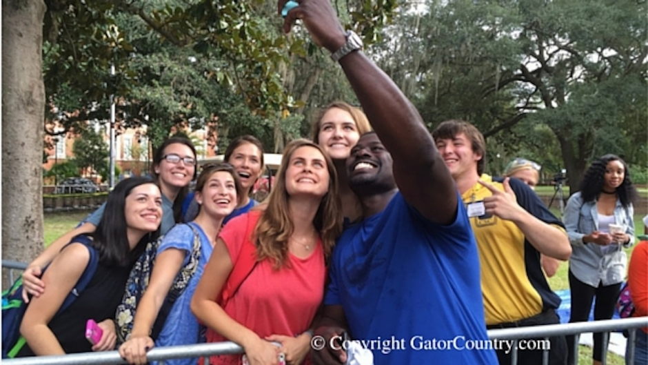 Alex Brown Takes Selfie with Florida Gators Football Fans