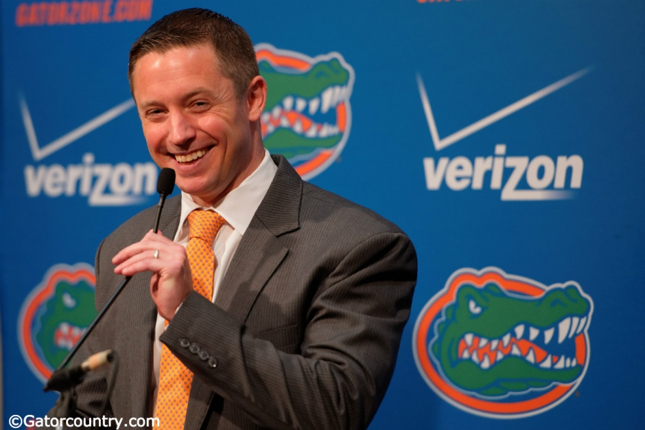 University of Florida head basketball coach Mike White at the podium for his first Florida Gators basketball media day appearence- Florida Gators basketball- 1280x852