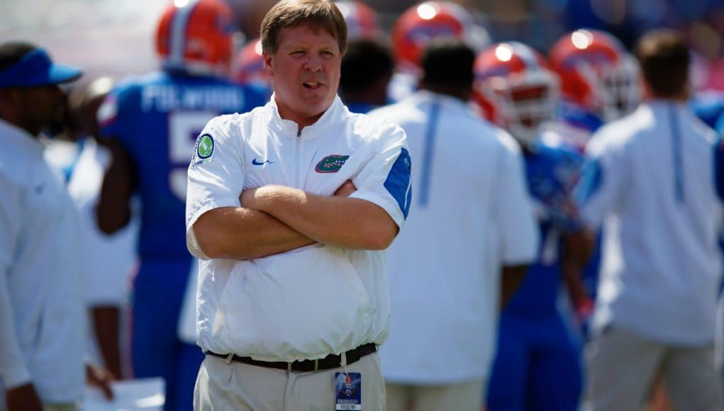 University of Florida head coach Jim McElwain observes his football team warming up before their game agianst Tennesse- Florida Gators football- 1280x852