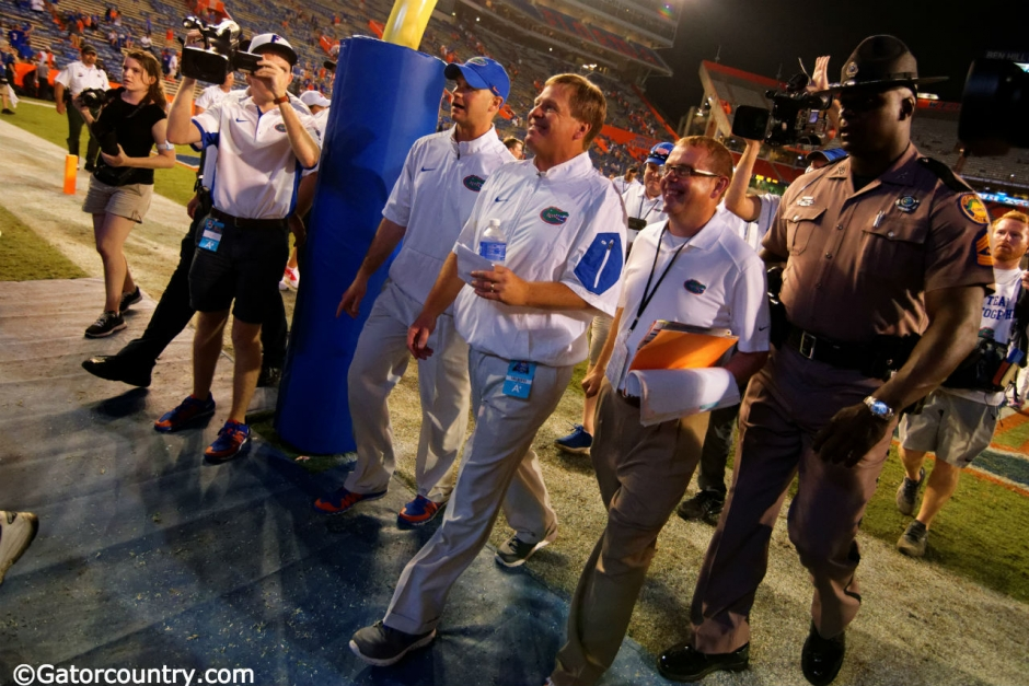 University of Florida head football coach Jim McElwain walks off of the field following his first win at Florida- Florida Gators football- 1280x852