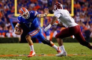 University-of-Florida-quarterback-Will-Grier-stiff-arms-a-defender-in-the-Florida-Gators-opening-game-Florida-Gators-Football-1280x851