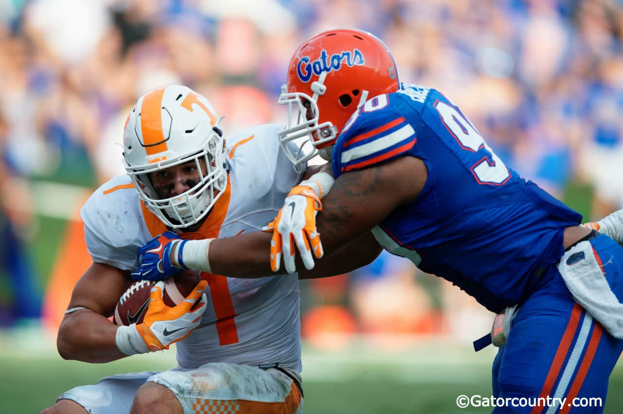 University of Florida senior defensive lineman Jon Bullard tackles Tennessee running back Jalen Hurd- Florida Gators football- 1280x852
