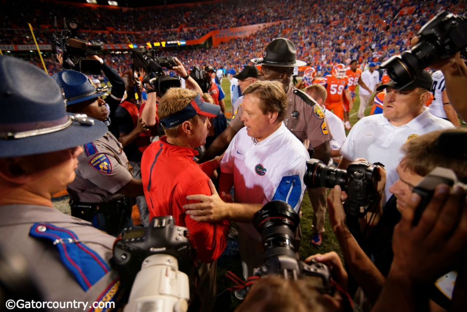 University of Florida head coach Jim McElwian greets Ole Miss head coach Hugh Freeze after Florida's 38-10 win over the Rebels- Florida Gators football- 1280x854