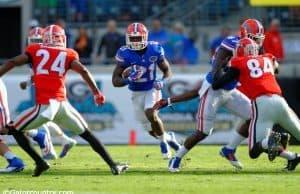 University of Florida running back Kelvin Taylor carries the ball against the Georgia Bulldogs in 2014- Florida Gators football- 1280x852