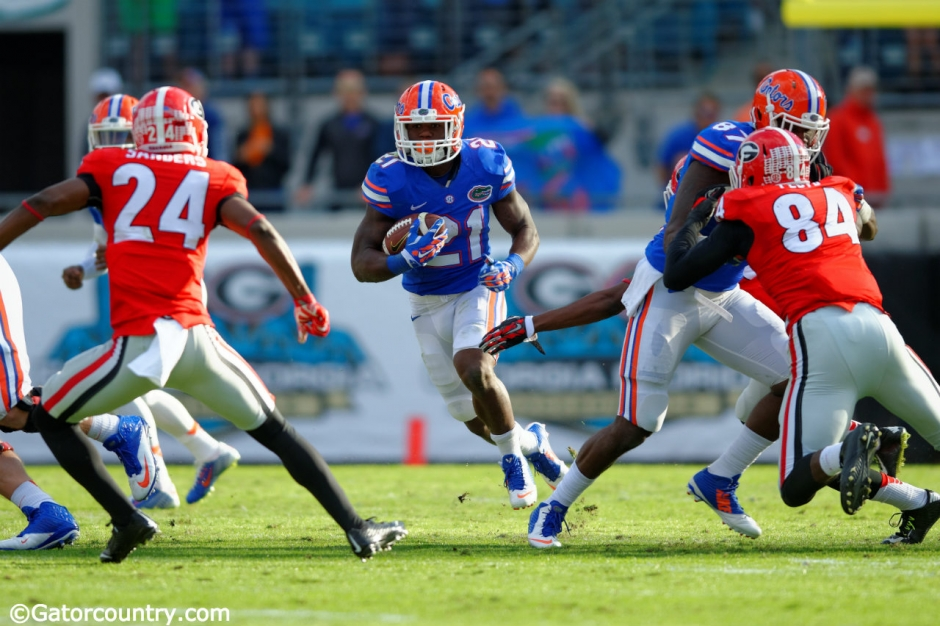 University of Florida running back Kelvin Taylor carries the ball against the Georgia Bulldogs in 2014- Florida Gators football- 1280x852