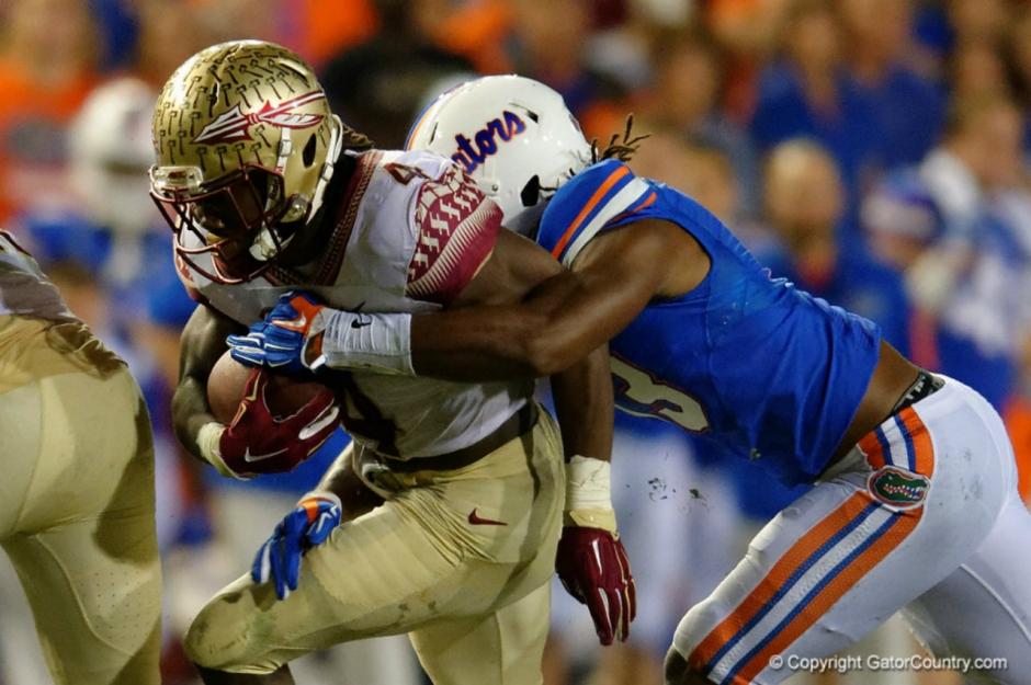 Daniel McMillian tackles Dalvin Cook in 2015- Florida Gators- 1280x851