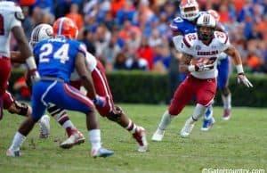 South Carolina running back Brandon Wilds runs against the Florida Gators in 2014- Florida Gators football- 1280x852