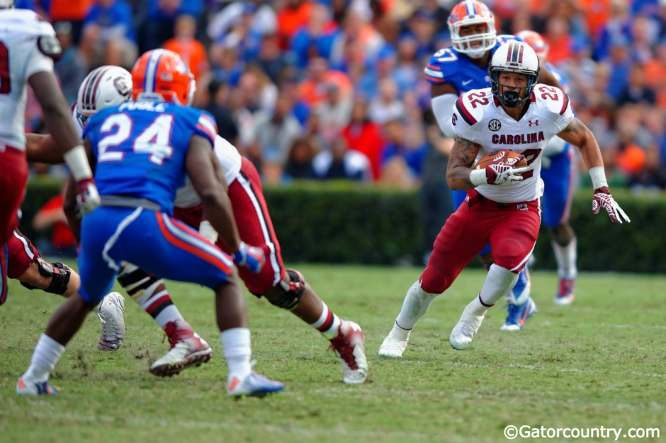 South Carolina running back Brandon Wilds runs against the Florida Gators in 2014- Florida Gators football- 1280x852