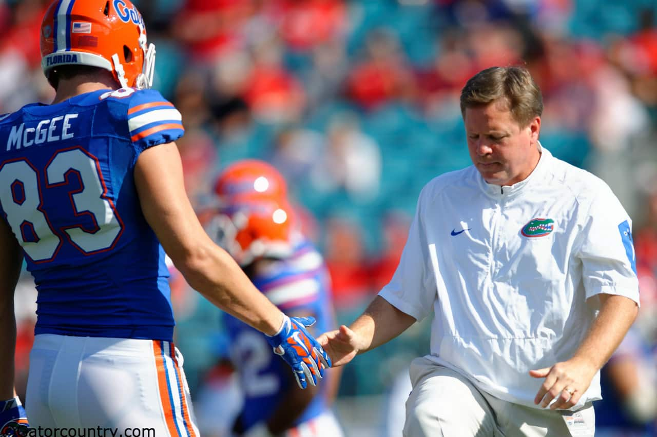 University of Florida head football coach Jim McElwain greets senior tight end Jake McGee before the Florida Gators game against Georgia- Florida Gators football- 1280x852