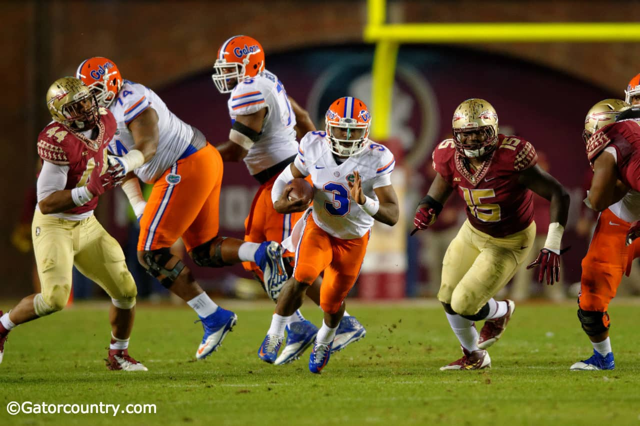 Florida Gators quarterback Treon Harris carries the ball against the Florida Stat Seminoles at Doak Campbell Stadium- Florida Gators football- 1280x852