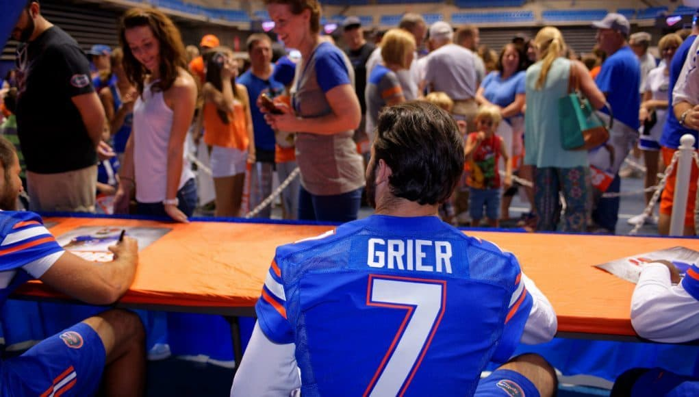 University of Florida redshirt freshman quarterback Will Grier signs  autographs for fans during Florida Gators football 62d4a3206