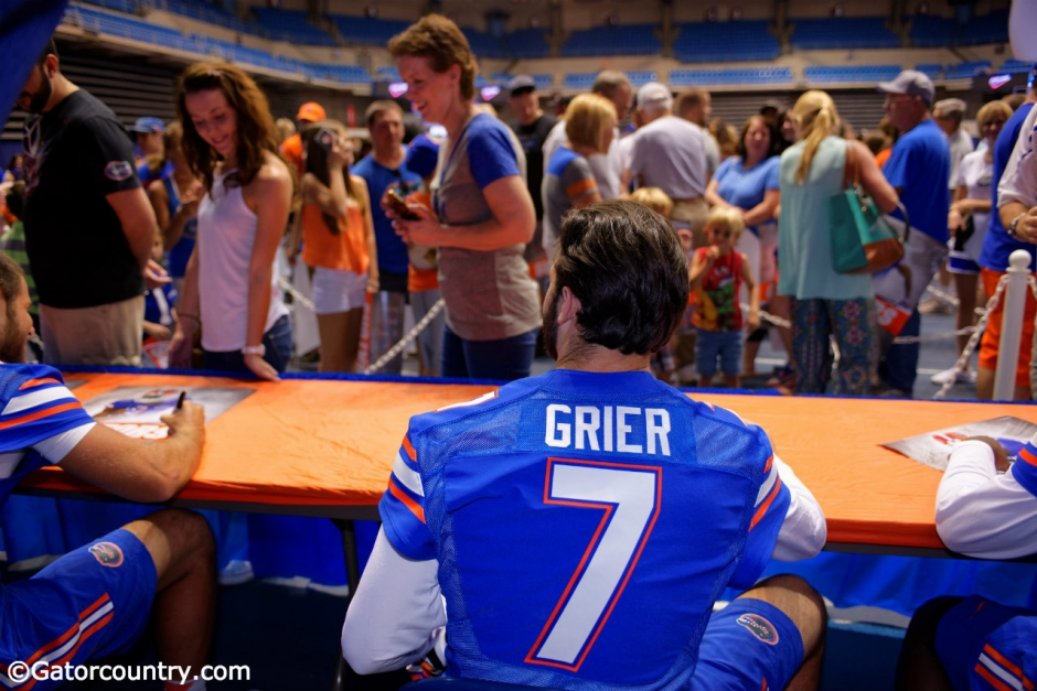 University of Florida redshirt freshman quarterback Will Grier signs autographs for fans during Florida Gators football fan day- Florida Gators football- 1280x854