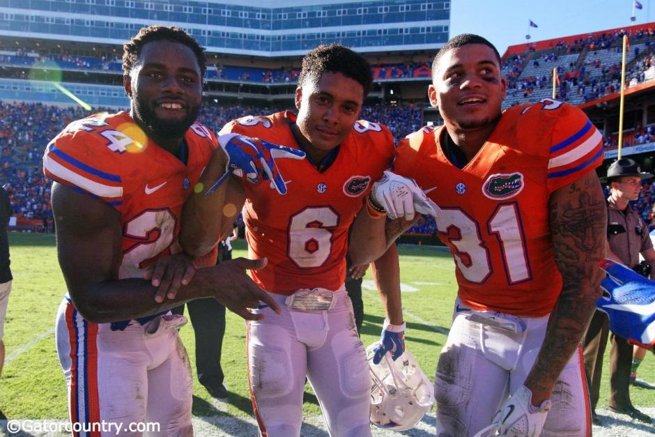 Florida Gators defensive backs Brian Poole, Quincy Wilson and Jalen Tabor celebrate Florida's win over the Vanderbilt Commodores- Florida Gators football- 1280x854