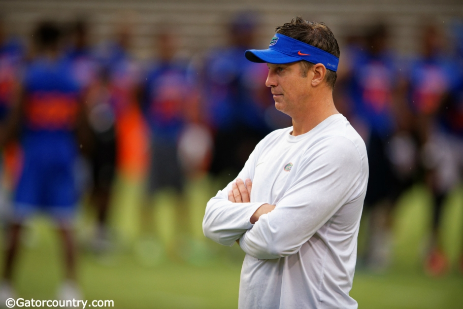 Florida Gators offensive coordinator Doug Nussmeier watches prospects work out during Friday Night Lights- Florida Gators football- 1280x854