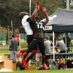 Florida Gators Wide Receiver Commit Josh Hammond Goes Up For Pass Over Gators Recruit JayVaughn Myers At Tuesday Practice of Under Armour All-American Game