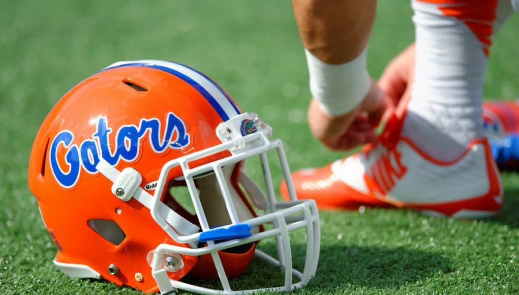 A Florida Gators player ties his shoe before the Buffalo Wild Wings Citrus Bowl- Florida Gators football- 1280x852
