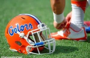 A Florida Gators player ties his shoe before the Buffalo Wild Wings Citrus Bowl- Florida Gators football- 1280x852