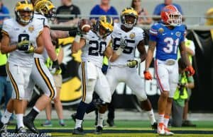 Michigan running back Drake Johnson celebrates a touchdown in Michigan's 41-7 win over the Florida Gators- Florida Gators football- 1280x852