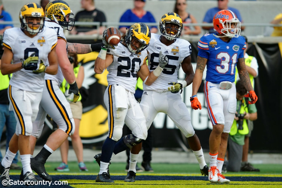 Michigan running back Drake Johnson celebrates a touchdown in Michigan's 41-7 win over the Florida Gators- Florida Gators football- 1280x852