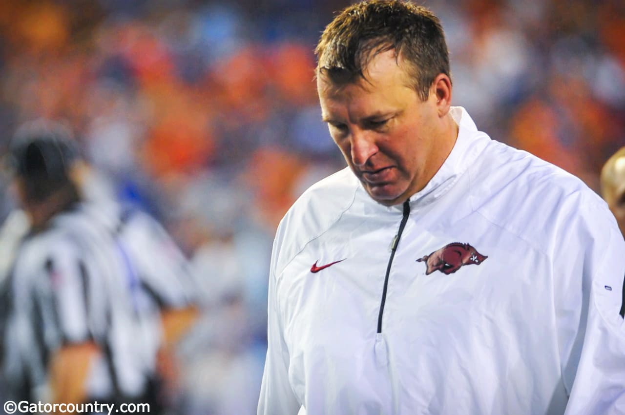 Arkansas Razorbacks head coach Bret Bielema walks off the field after a 2013 loss to the Florida Gators football team- Florida Gators football- 1280x850
