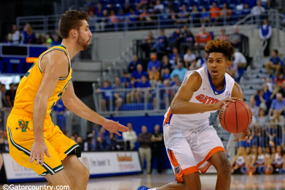 Florida Gator sophomore forward Devin Robinson dribbles in a win over Vermont- Florida Gators basketball- 1280x852