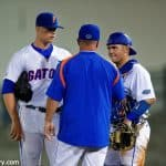 Kevin O'Sullivan meets with catcher Mike Rivera and starting pitcher Logan Shore during a win over Auburn- Florida Gators baseball- 1280x854