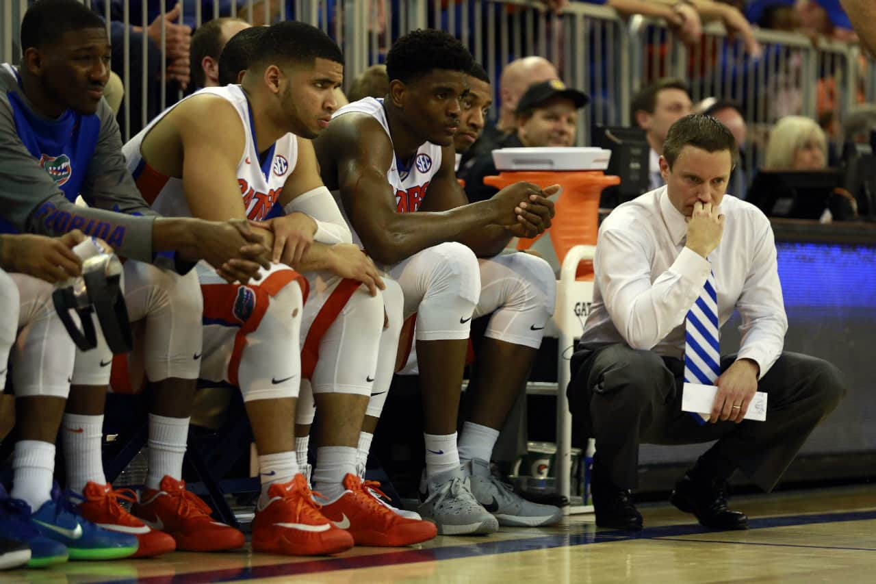 Feb 13, 2016; Gainesville, FL, USA; Florida Gators head coach Mike White and bench looks on during the second half against the Alabama Crimson Tide at Stephen C. O'Connell Center. Alabama Crimson Tide defeated the Florida Gators 61-55. Mandatory Credit: Kim Klement-USA TODAY Sports