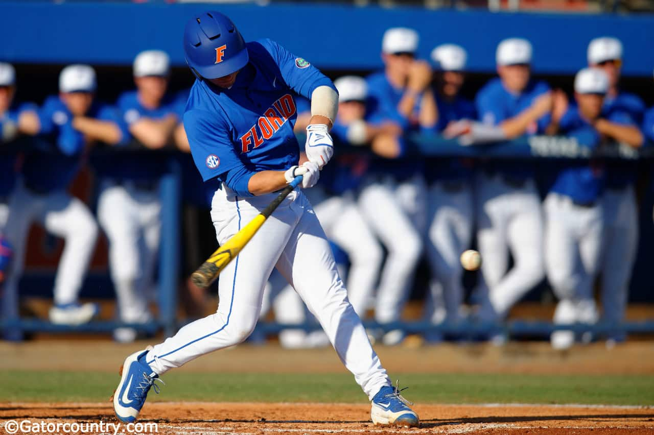 Florida Gators third baseman Jonathan India hitting in a win against Florida Gulf Coast University to start the season 2-0. February 20th, 2015- Florida Gators baseball- 1280x852