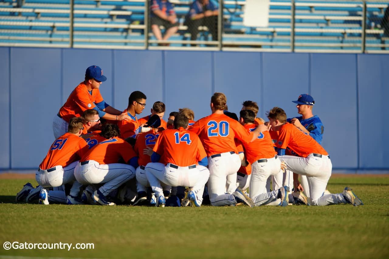 The University of Florida baseball team huddles up before its game against the Florida State Seminoles at McKethan Stadium- Florida Gators baseball- 1280x852