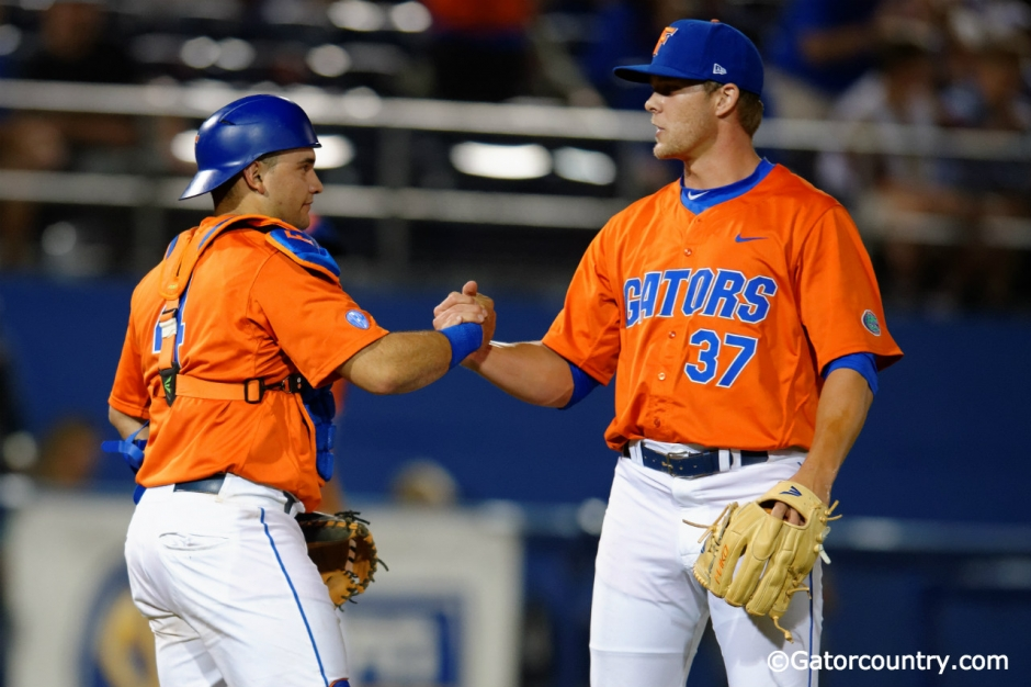 University of Florida Cather Mike Rivera congratulates Shaun Anderson following the Florida Gators 6-0 win over Florida State- Florida Gators baseball- 1280x852