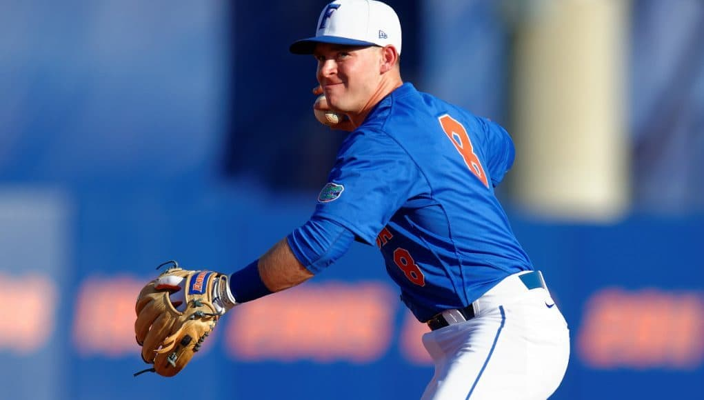 University of Florida freshman infielder Deacon Liput makes a play to first base in a win against Florida Gulf Coast- Florida Gators baseball- 1280x852