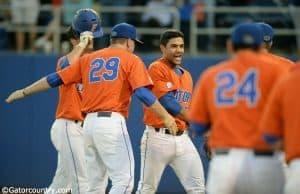University of Florida freshman outfielder Nelson Maldonado is greeted by teammates after his home run against FSU- Florida Gators baseball-1280x852
