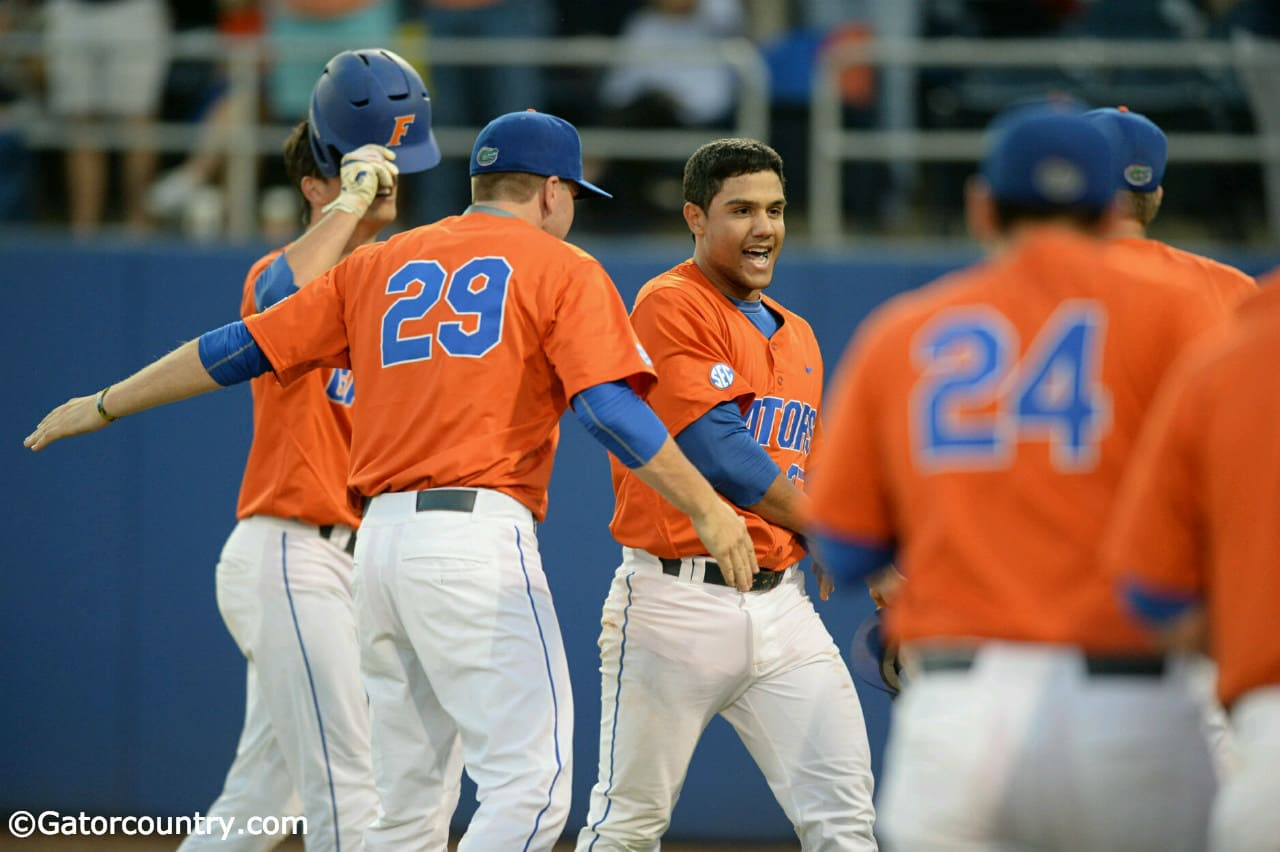 University of Florida freshman outfielder Nelson Maldonado is greeted by teammates after his home run against FSU- Florida Gators baseball-1280x852