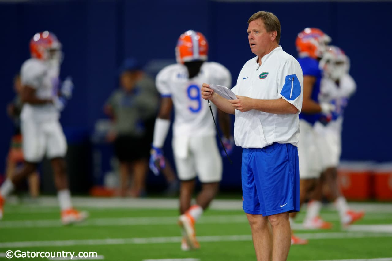 University of Florida head coach Jim McElwain watches over his football team during a practice inside Florida's indoor practice facility- Florida Gators football- 1280x852