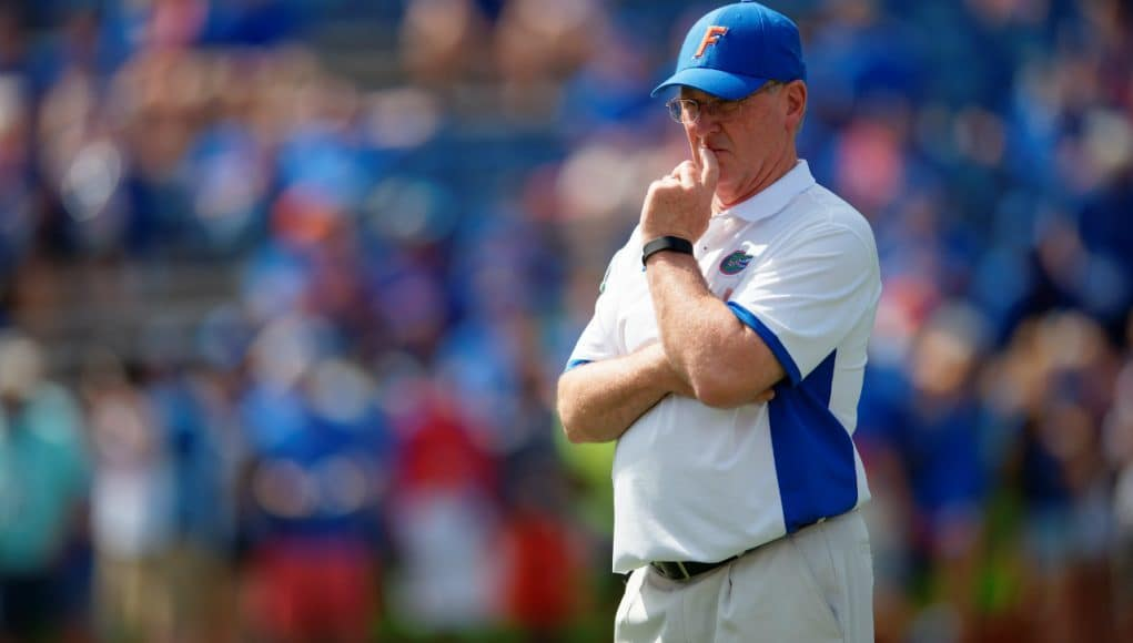 University of Florida offensive line coach Mike Summers watches his group warm up before playing Tennessee in 2015- Florida Gators football- 1280x852