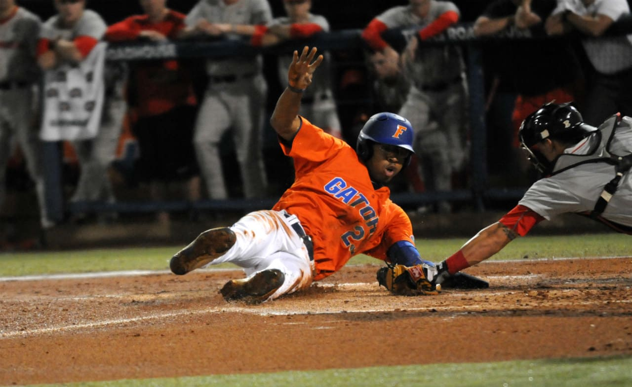 Buddy Reed slides around the tag and successfully steals home against Georgia on Friday, April 22 - Photo courtesy of Jordan McPherson / The Independent Florida Alligator